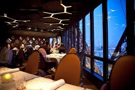 dining at the eiffel tower in paris france. restaurant jules verne is in the eiffel tower dining at paris france n