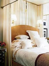 bedroom sconce lighting. wall lights bedroom with swing arm sconces and candle sleeves mounted over a headboard sconce lighting m