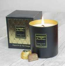 whisky and chocolate scented candle in black glass