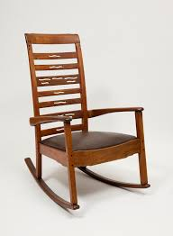 ladder back rocking chair with leather seat arms are softly rounded and a is articulated