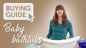woman behind baby bathtub with text ing guide baby bathtubs
