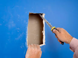 how to fix large holes in drywall with