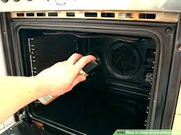 how to self clean oven cleaning door glass between window tool