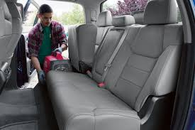 get the job done with the 2018 toyota tundra s specs features man loading a geberator into the folded up rear seat of the 2018 toyota tundra o