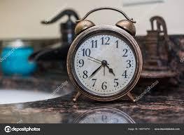 rustic bell alarm clock in bathroom stock photo