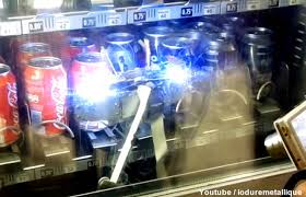 How To Steal From A Vending Machine Classy Man Builds Robot To Steal Soda From Vending Machines Geekologie