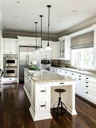 white kitchen cabinets with dark floors off white kitchen cabinets dark floors