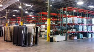 new two story executive offices customer service area tile showroom slab showroom and inventory warehouse