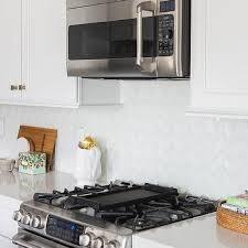 white glass herringbone kitchen tiles by arizona tiles