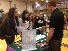 teeming teens career fair draws em in montana education butte high students check out highlands college table at school career fair