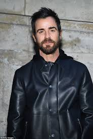 handsome justin 46 looked typically chic as he rocked all black including a