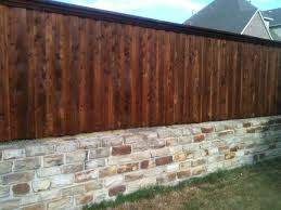 stone wall with fence top connect