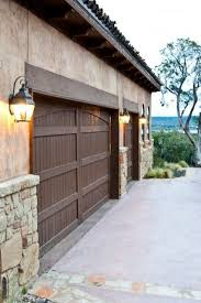 exterior garage door header wooden garage door wooden garage doors and stucco and stone terranean garage and shed by collinas design