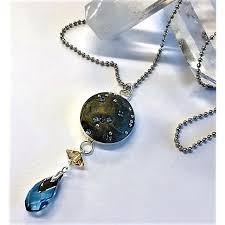 make this constellation pendant with a swinging crystal pendulum using swarovski ceralun ceramic clay created by sondra barrington