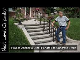 steel handrail to concrete steps