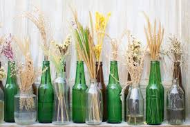 using glass bottles to decorate your home is an economic and environmentally friendly way to make your home more beautiful in this article we ll give you