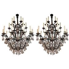 magnificent pair of large twenty one light crystal chandeliers for