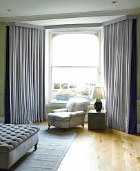 cool design hanging curtains on bay windows ideas