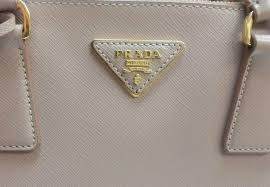 designer label s we felt it important to do some digging and find out exactly what saffiano leather is and are we really getting what we pay for