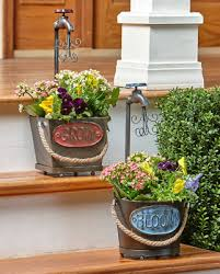 whimsical rustic water faucet flower planters outdoor metal garden pots planter