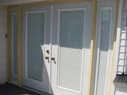 interior double glass door with white wooden frame plus white blinds and golden handlers between