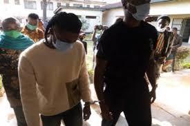 PHOTOS: Omah Lay, Tems still in handcuffs in Uganda