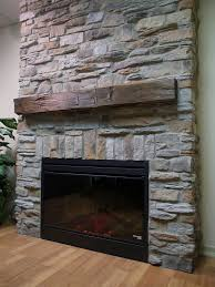 inspiring rock fireplace design ideas with wooden flooring decoration