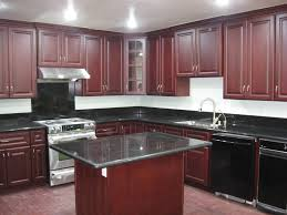 kitchen ideas cherry cabinets. Kitchen. Brown Varnished Cherry Wood Kitchen Cabinet And Rectangular Island With Black Countertop On Ideas Cabinets