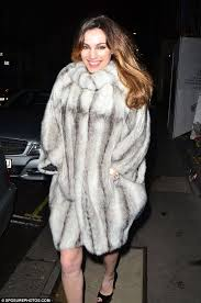 keeping warm kelly brook stepped out in london on new year s eve wearing a faux