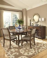 legacy clic thornhill round leg table dining set in cinnamon finish