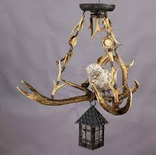 antique black forest antler chandelier with owl statue for a nice ceiling lamp made of deer antlers and hornroses with a teracotta owl and