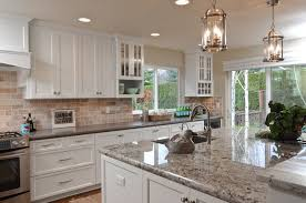 white shaker cabinets with quartz countertops. white painted shaker kitchen cabinets, granite island, grey quartz countertop, pendent lighting, cabinets with countertops