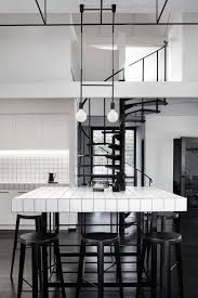 black and white office design. An Oversized Black Grid Structure Weaves Throughout The Office Allowing Plants To Grow And Evolve Over Time. As Grow, It Helps Create White Design D