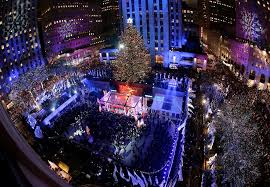 people watch as the rockefeller center tree is lit during a ceremony on wednesday dec 2 2016 in new york the norway spruce tree stands at