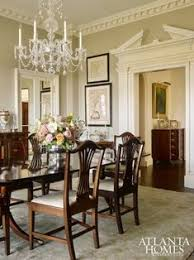 a crystal chandelier from baccarat takes center se in the dining room the rug from moattar set the tone for the soft green color palette
