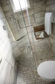 A full glass shower provides clear views of elegant and polished floor to  ceiling porcelain tile
