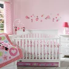 bedroom white wooden cradles with pink minnie mouse bedding set and flowers placed on the