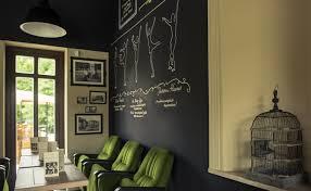 surprising varosliget cafebar wall decor in chalk board concept to match with plenty of displayed framed