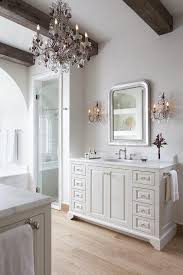 rustic french bathroom with wood ceiling beams