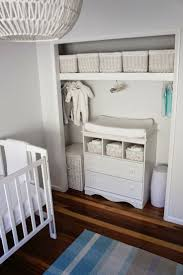 closet changing table, neutral nursery, white grey aqua. White storage for  unisex baby