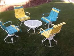 bine White Round Table and Colorful Chairs from Homecrest Patio Furniture on Grass Yard