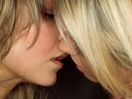 Blonde teens kissing in