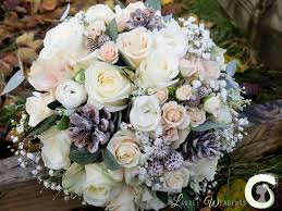flower cones for wedding. winter bouquet of roses, gypsophila and pine cones flower for wedding