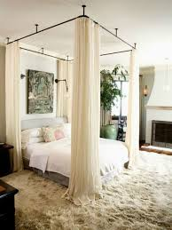 Bed canopy. Staple shirred fabric to a wood furring strip, fold over once  to hide the wood, then nail or screw to the ceiling.