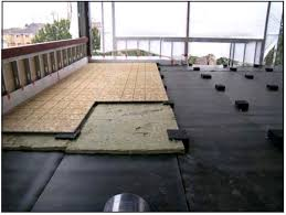 building conversion floors using mass loaded vinyl to seal existing structure and a discrete isolator floating floor system