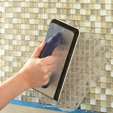 applying un sanded grout using a float via com