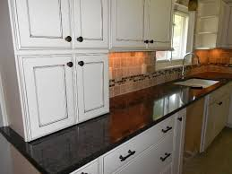 black quartz countertops white cabinets