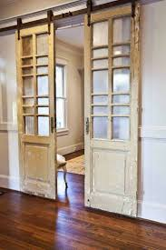 love that these are old french doors and they used them for the