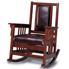 wooden rocking chair. wooden rocking chair - padded leather dark oak wood finish rocker