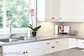 maple cabinets painted cloud white soapstone formica countertops and gray